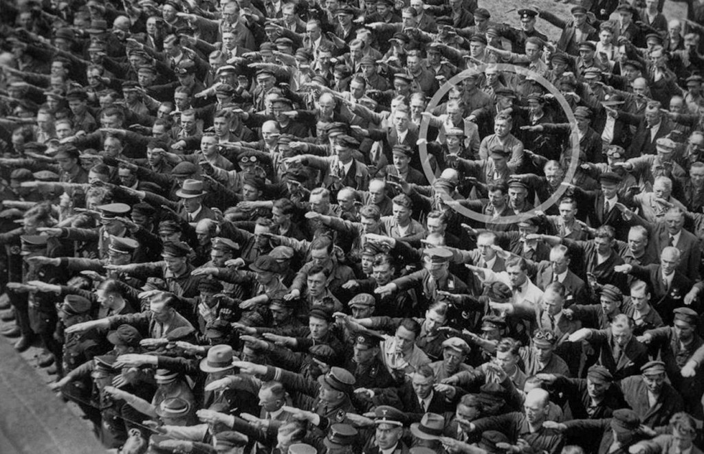 A lone man refuses to do the Nazi salute, 1936.